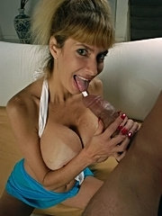 Mature lady with cum all over her large old tits
