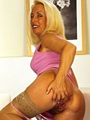 Mature busty older lady with cum her large breasts