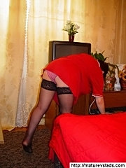 Aged babe in red crazily enjoys swallowing hard cock of young lad
