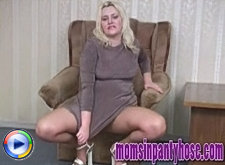 Busty mature blondie shows off in tan pantyhose