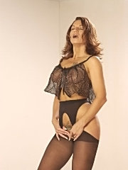 Pretty mommy posing sexily in stockings