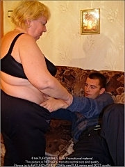 Depraved blonde grandmother in black underwear undressing a guy and sucking his young cock greedily