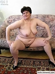 Brunette fat mom exhibiting body?s charms.