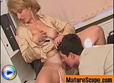 Mature businesswoman gets a hot oral favor from young worker