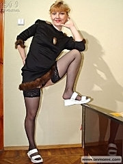 Milf in black dress and stockings